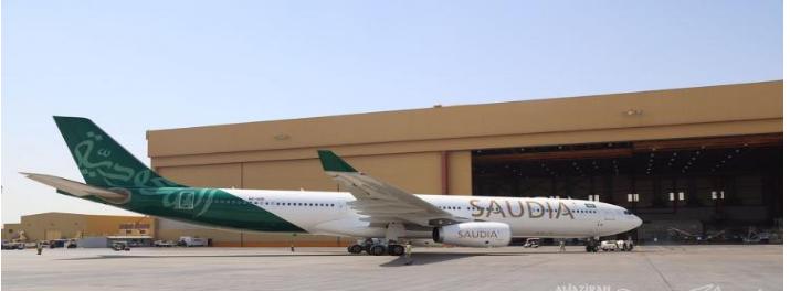 """بمناسبة اليوم الوطن.. طائرة لـ """"الخطوط السعودية"""" تتزين بالأخضر وتجوب المناطق"""